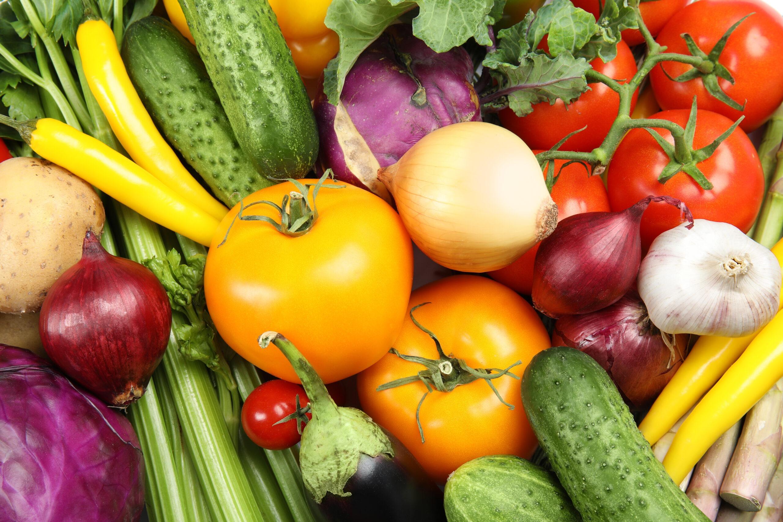 Many fresh ripe vegetables as background. Organic food